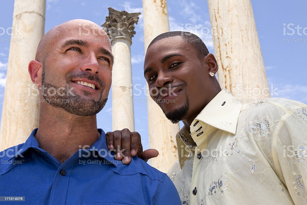 Smiling Gay Couple Looks for Support stock photo