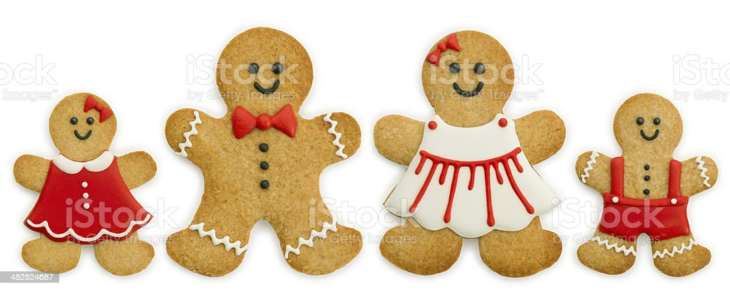 Smiling gingerbread cookie family on white background stock photo