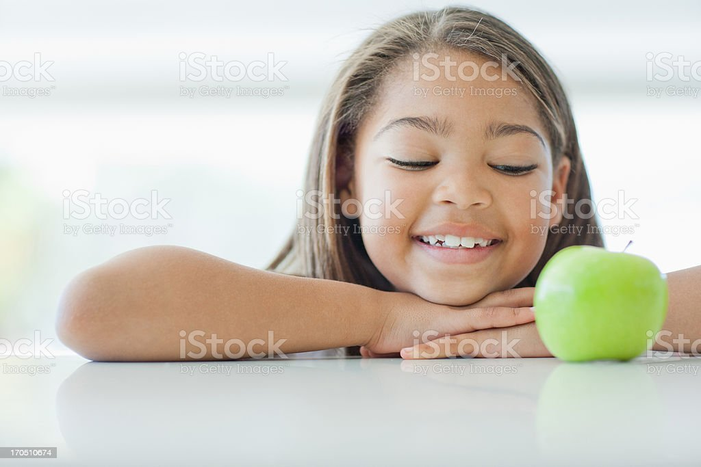 Smiling girl and green apple royalty-free stock photo