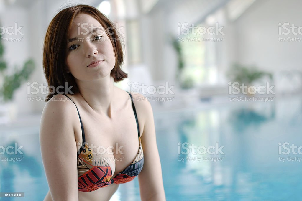Smiling girl at the swimming pool royalty-free stock photo
