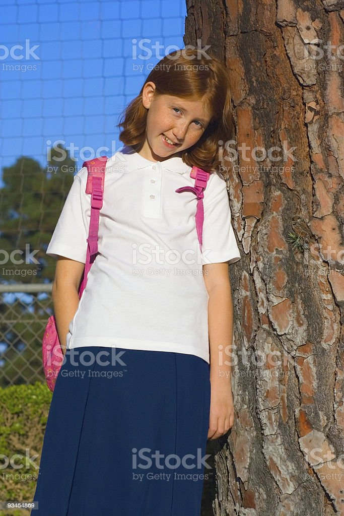 Smiling girl by the tree stock photo