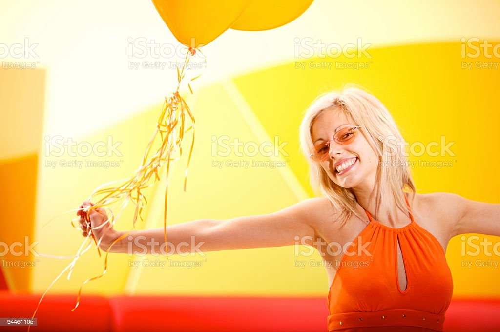 smiling girl celebrating in orange stock photo