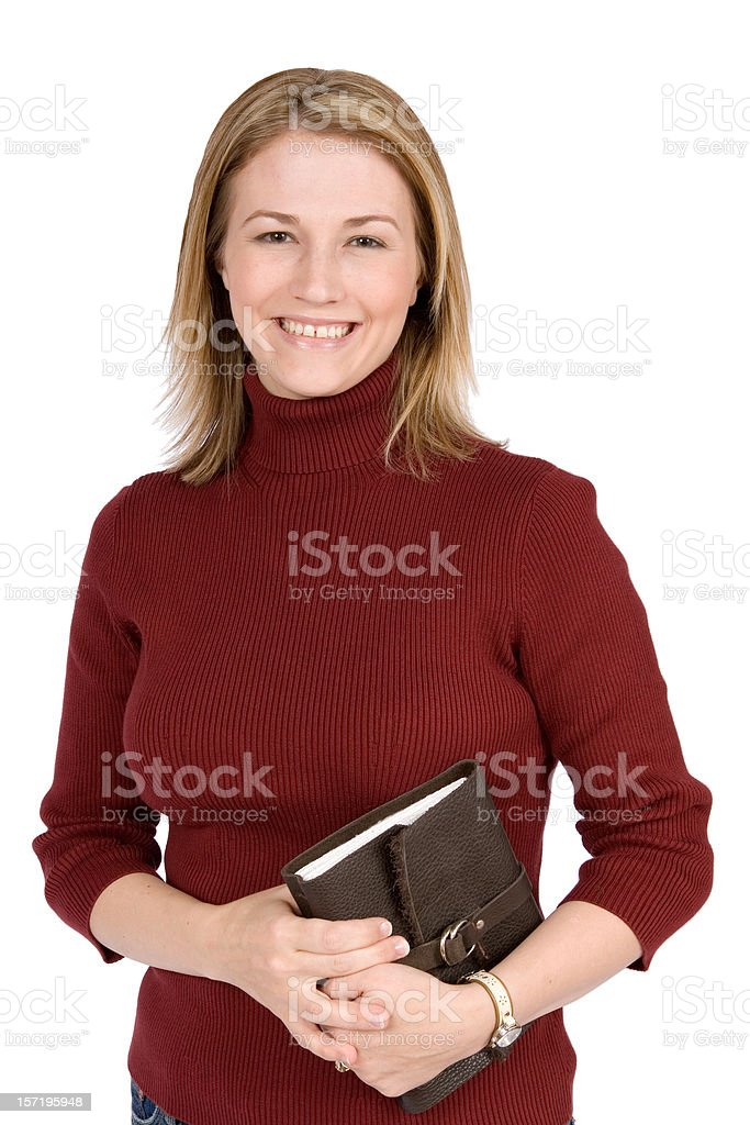 Smiling girl holding book royalty-free stock photo
