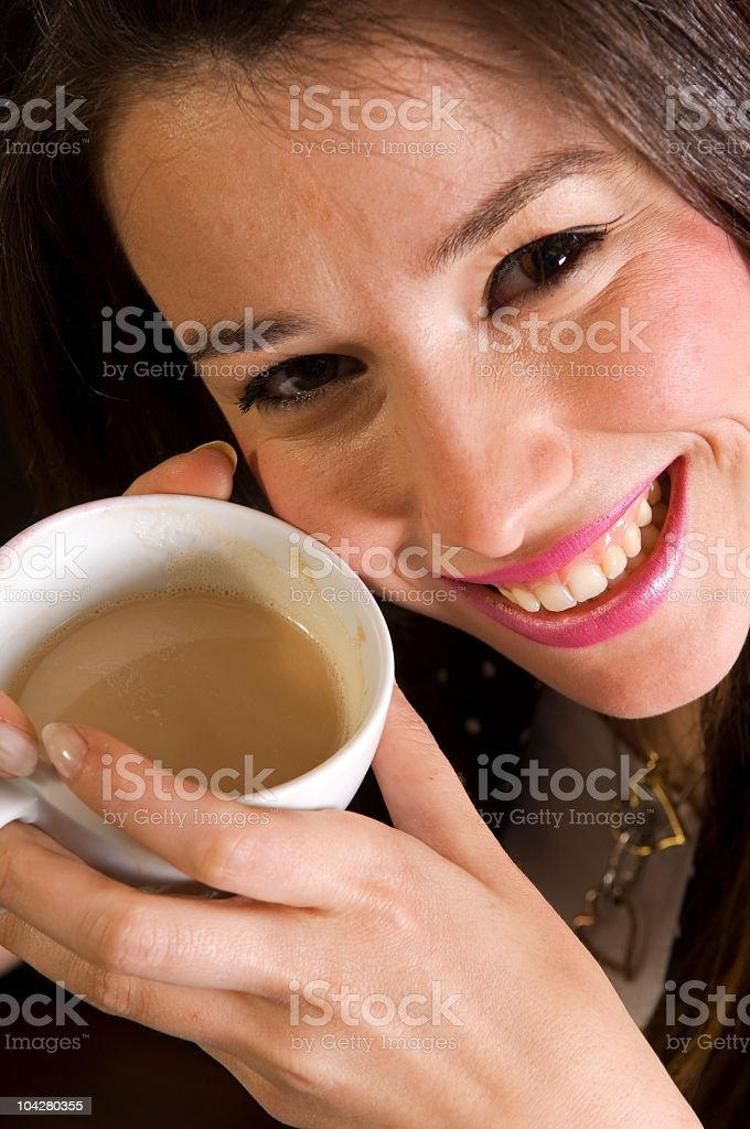 smiling girl holding coffee cup royalty-free stock photo