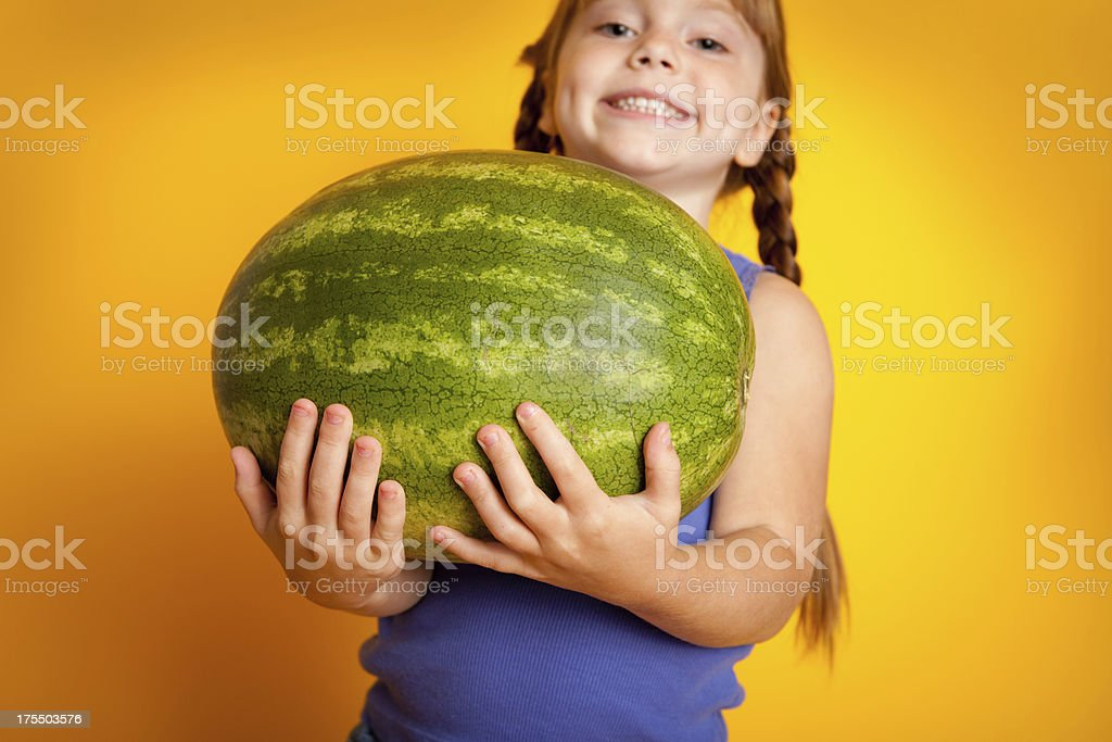 Smiling Girl Holding Large Watermelon royalty-free stock photo