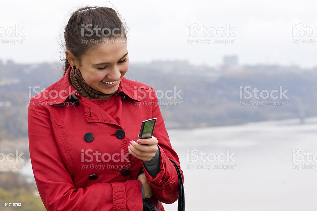 Smiling Girl Holding Mobile Phone royalty-free stock photo