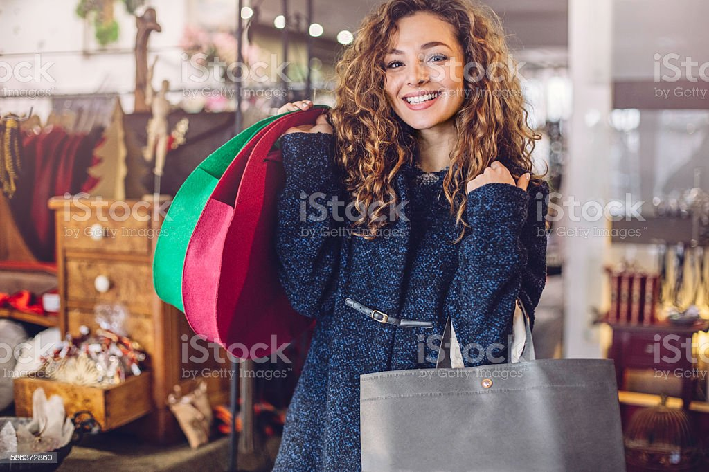 Smiling girl holding shopping bags stock photo