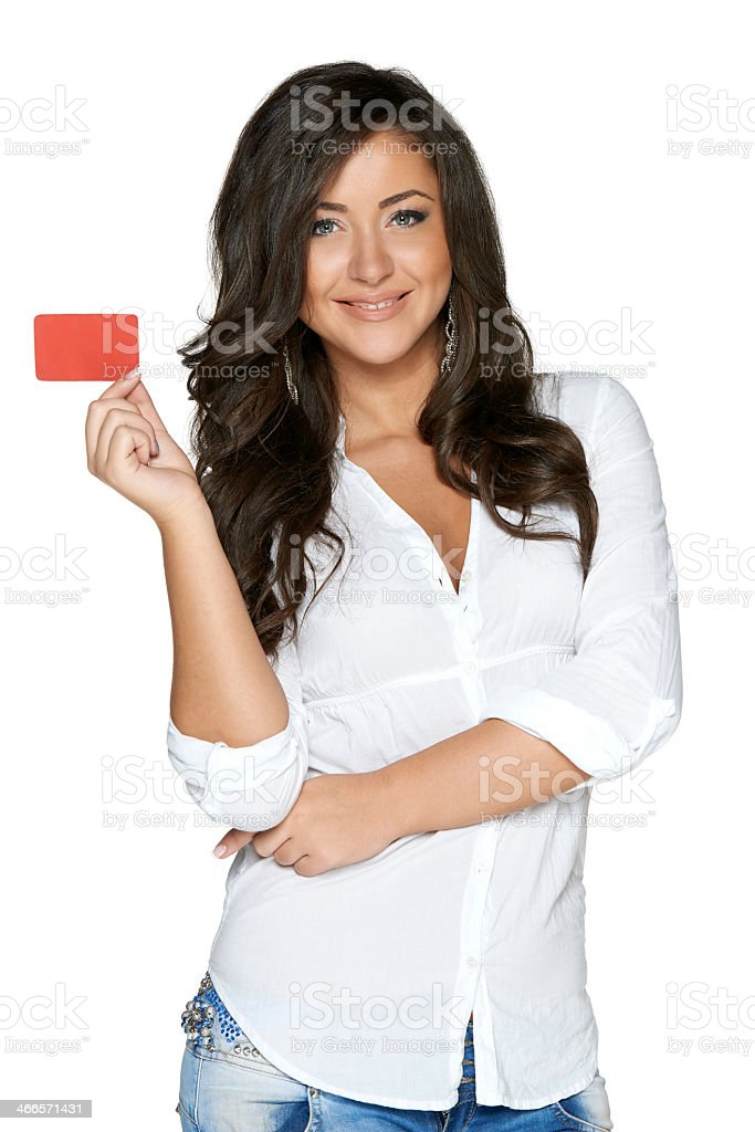 Smiling girl holding up red card with the other arm crossed stock photo