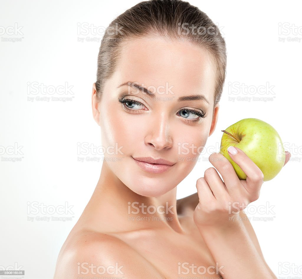 Smiling girl  holds a green apple. stock photo