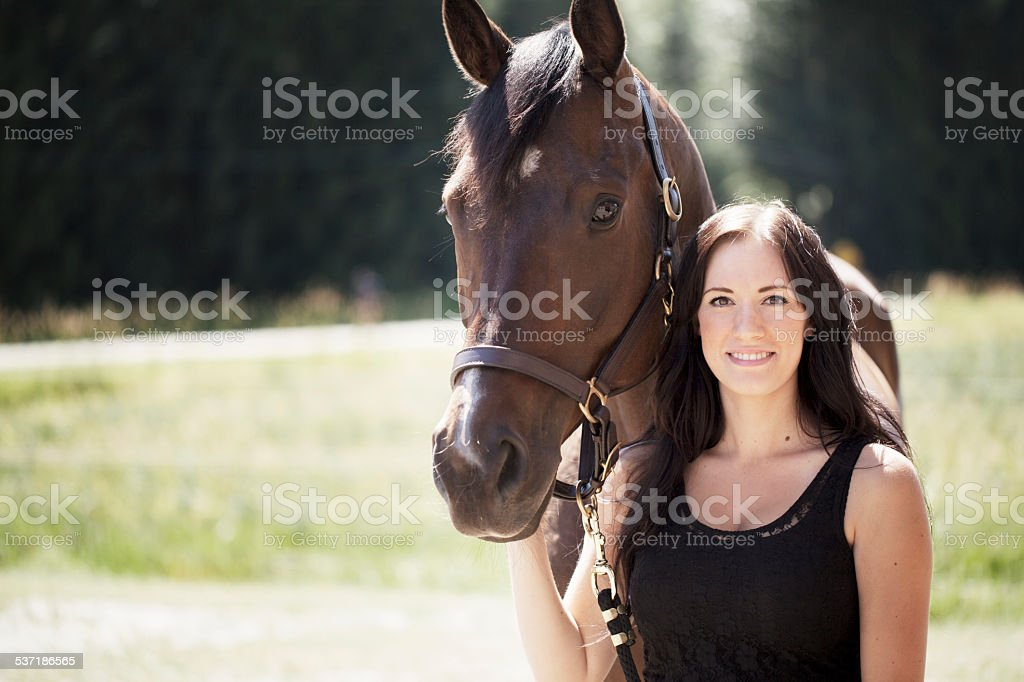 Smiling girl & horse stock photo