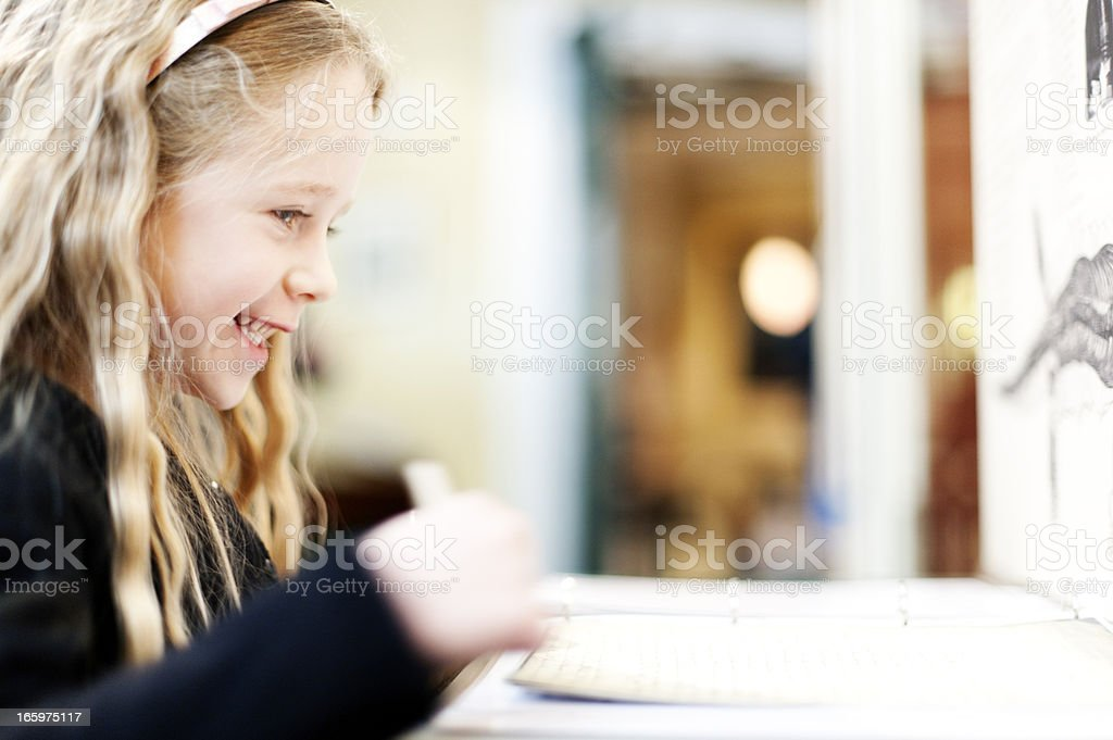 Smiling girl in a museum royalty-free stock photo