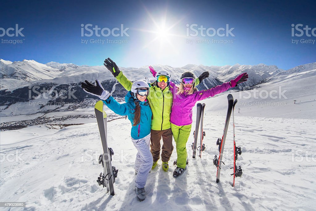 Smiling girl in blue jacket skiing alps resort stock photo
