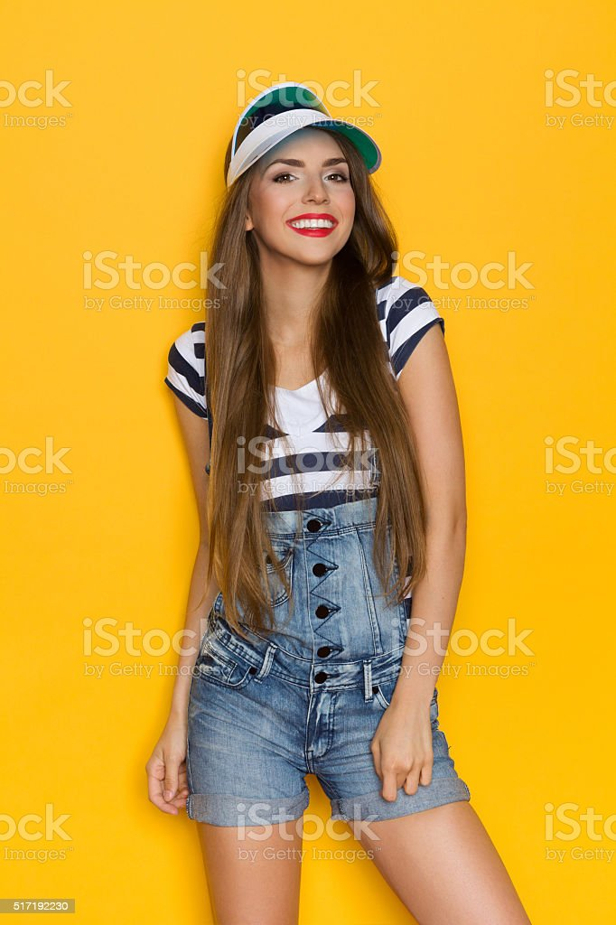 Smiling Girl In Dungrees And Transparent Cap stock photo