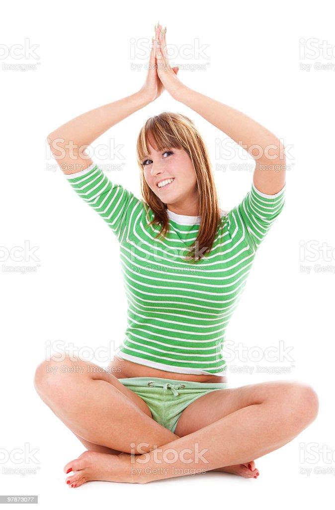 Smiling girl in lotus pose royalty-free stock photo