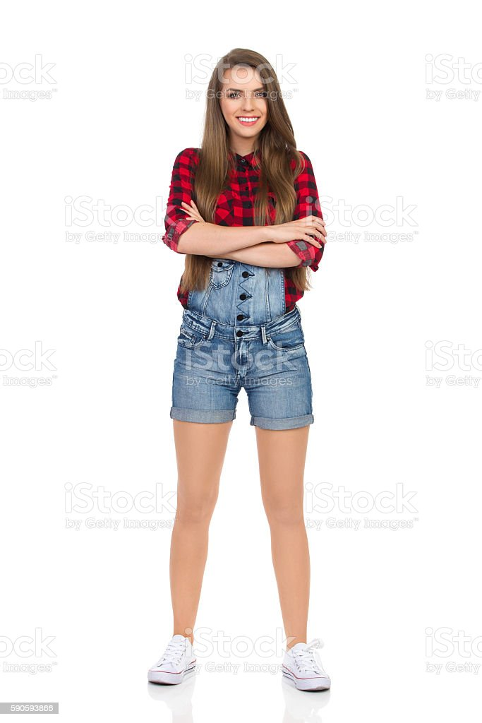 Smiling Girl In Lumberjack Shirt With Arms Crossed stock photo