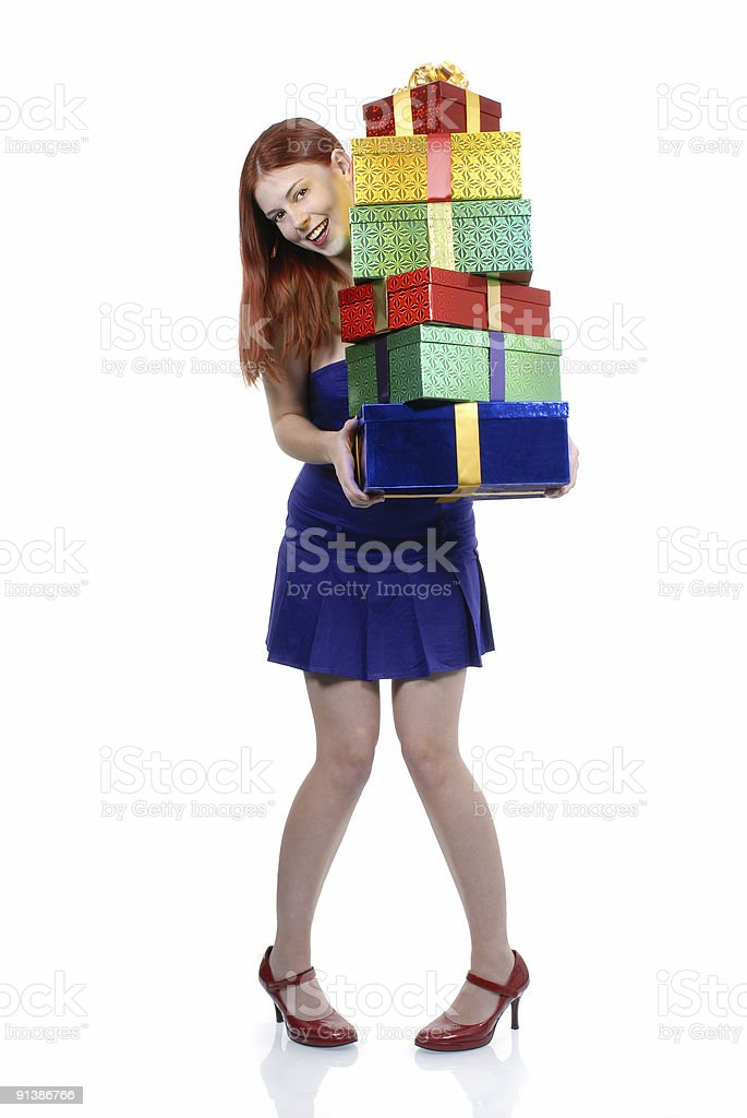 Smiling girl in red shoes with gifts royalty-free stock photo