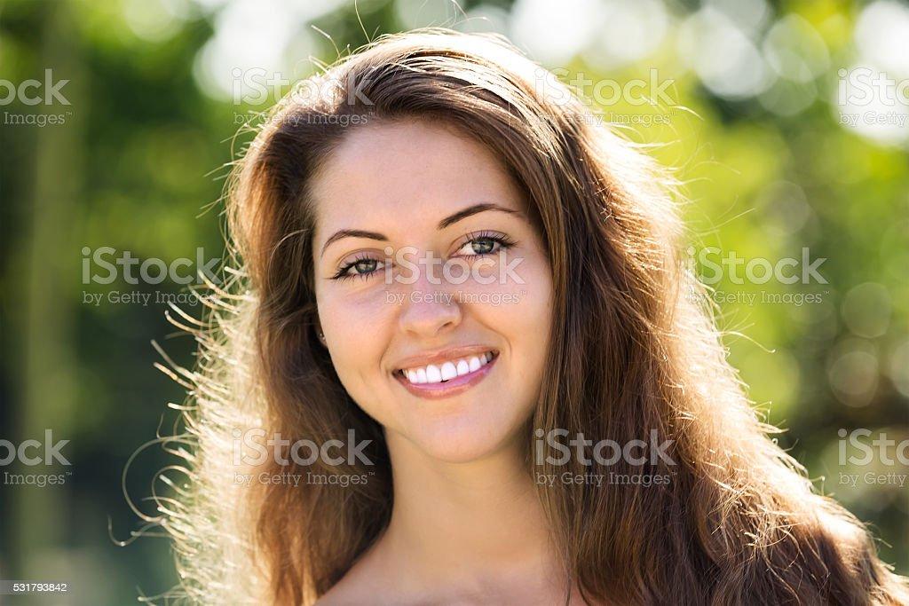 Smiling girl in summer park stock photo