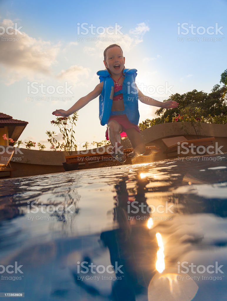 Smiling girl in swimming pool royalty-free stock photo