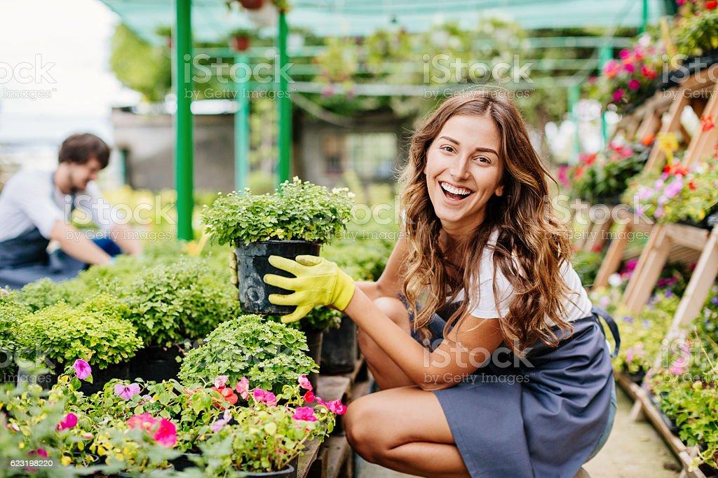 Smiling girl in the garden center stock photo