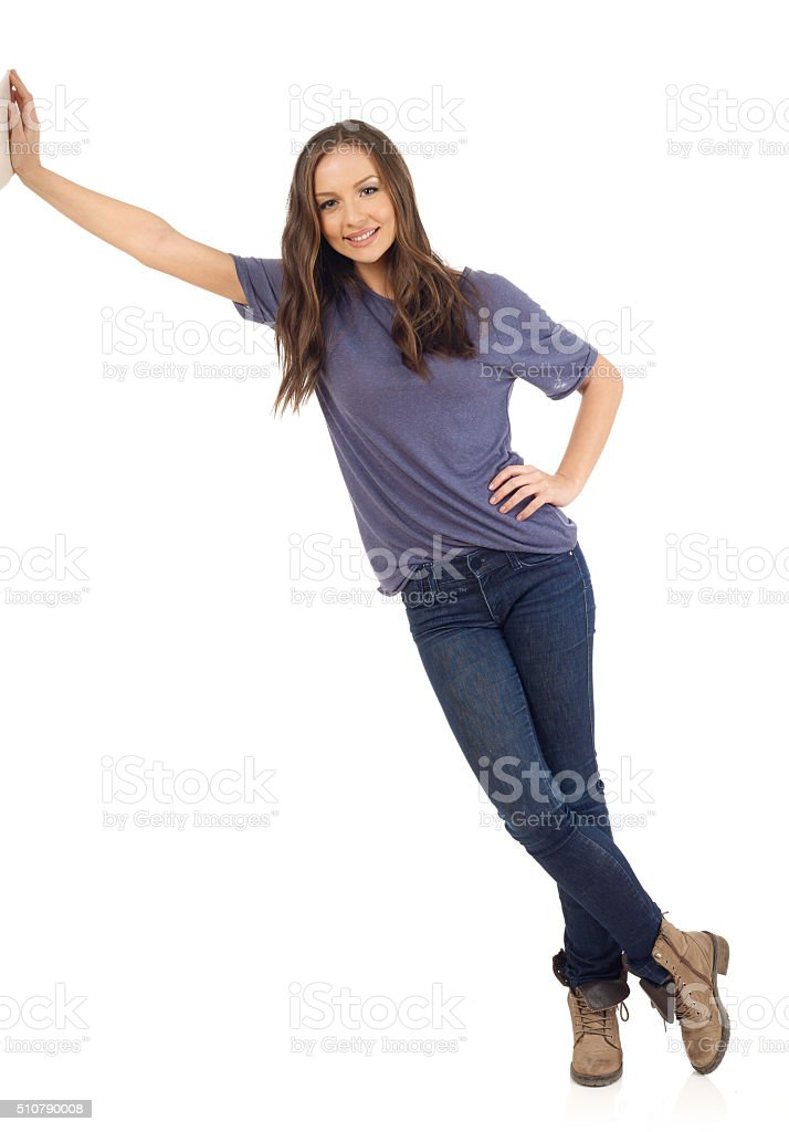 Smiling girl lean on wall stock photo