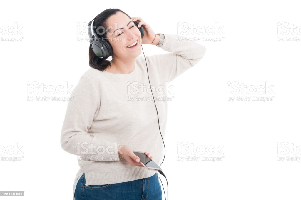 Smiling girl listening music with closed eyes stock photo