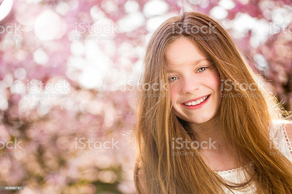 Smiling girl looking at camera in spring royalty-free stock photo
