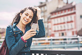 Smiling girl looking at her smart phone