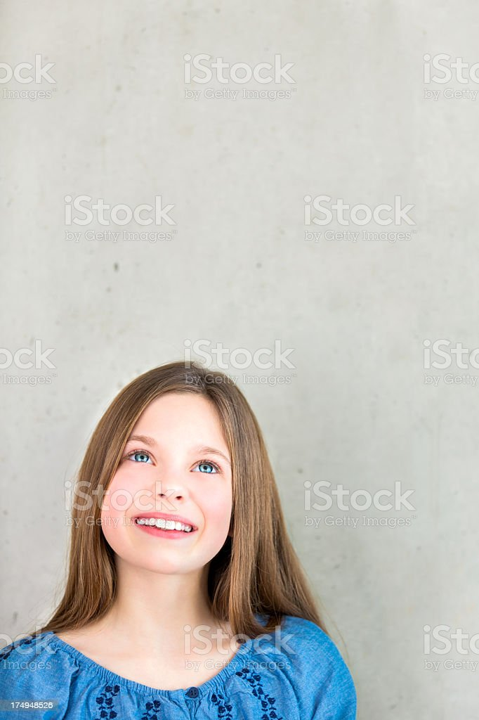 Smiling Girl looking to copy space royalty-free stock photo
