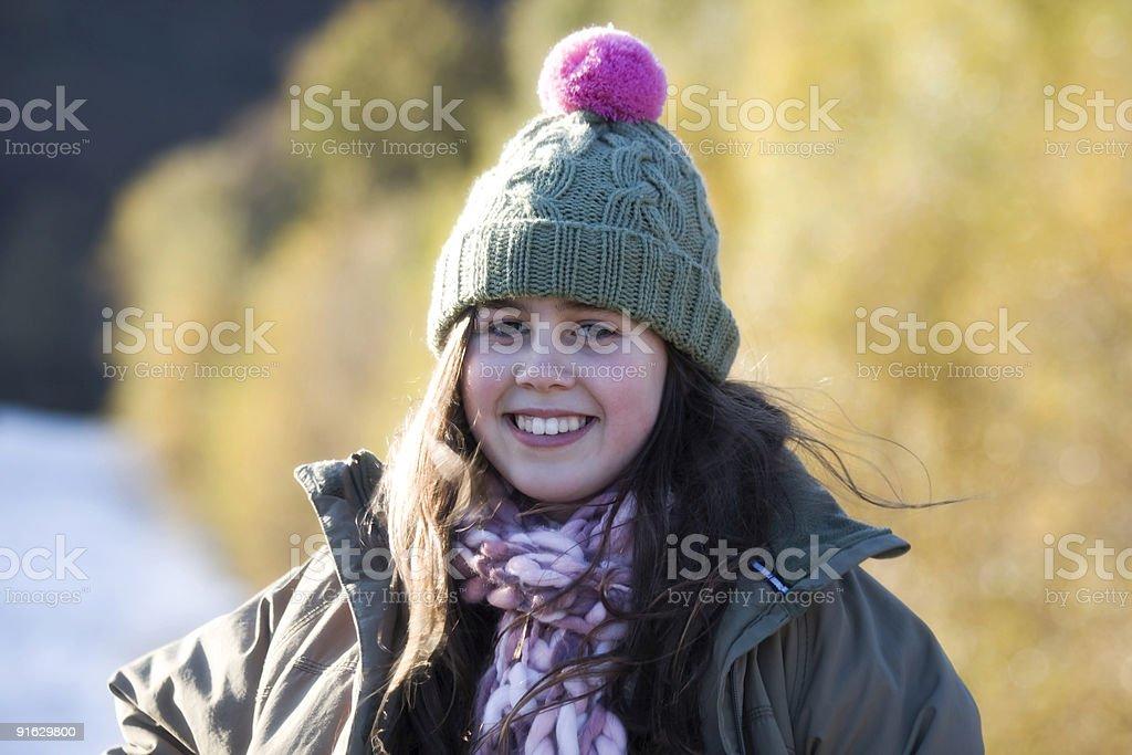 Улыбающаяся девочка в зимний день Стоковые фото Стоковая фотография