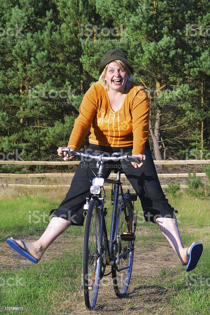 Smiling girl on cycle stock photo