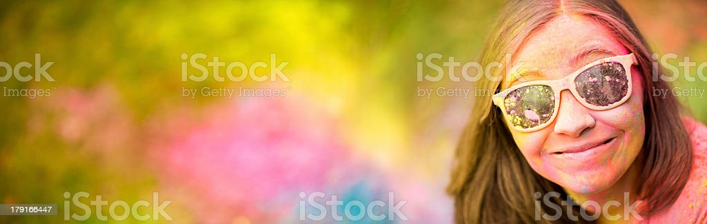 Smiling Girl on Holi Festival with colorful copy space royalty-free stock photo
