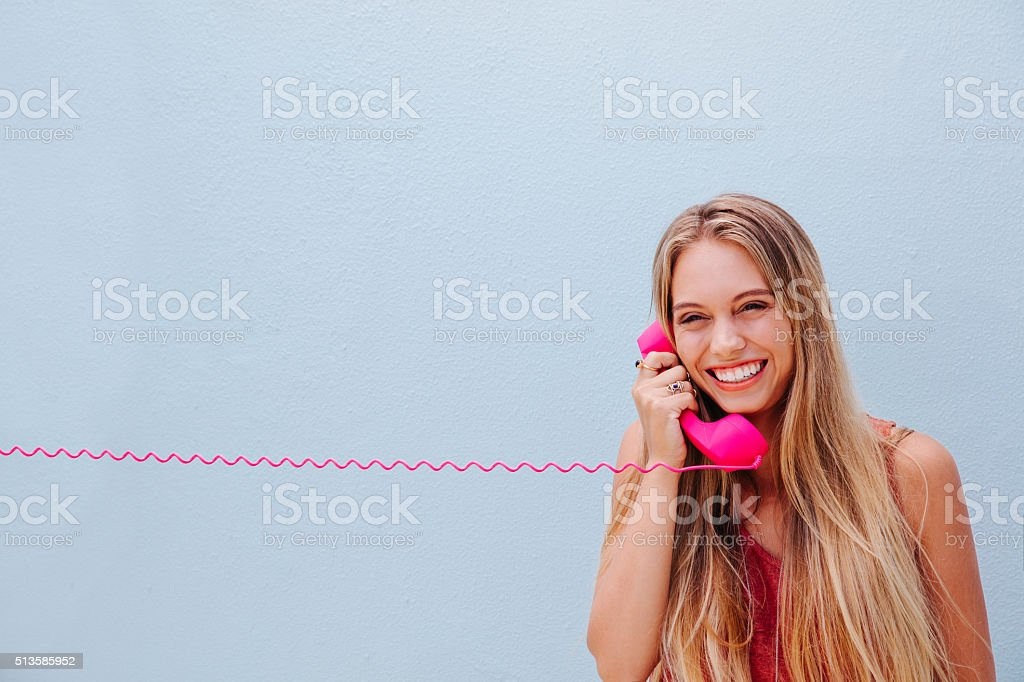 Smiling girl on vintage telephone stock photo