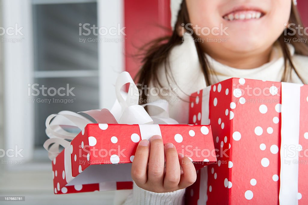 Smiling girl opening christmas present royalty-free stock photo