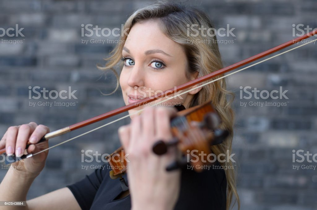Smiling girl play violin stock photo