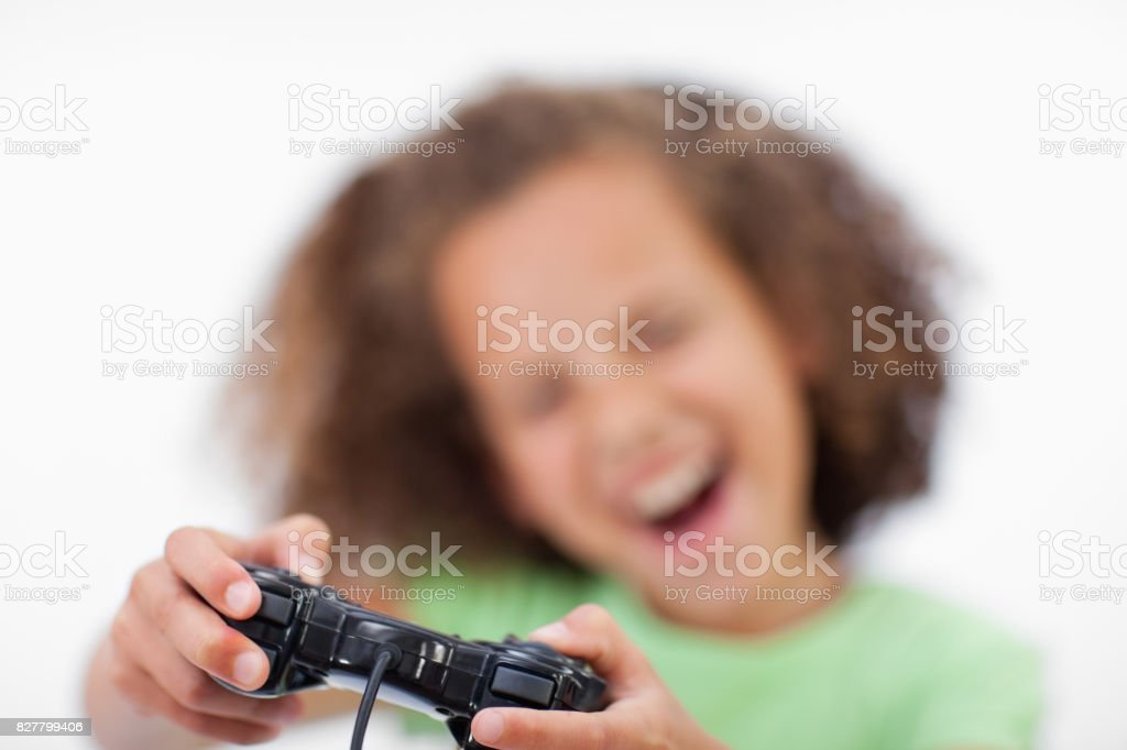 Smiling girl playing a video game stock photo