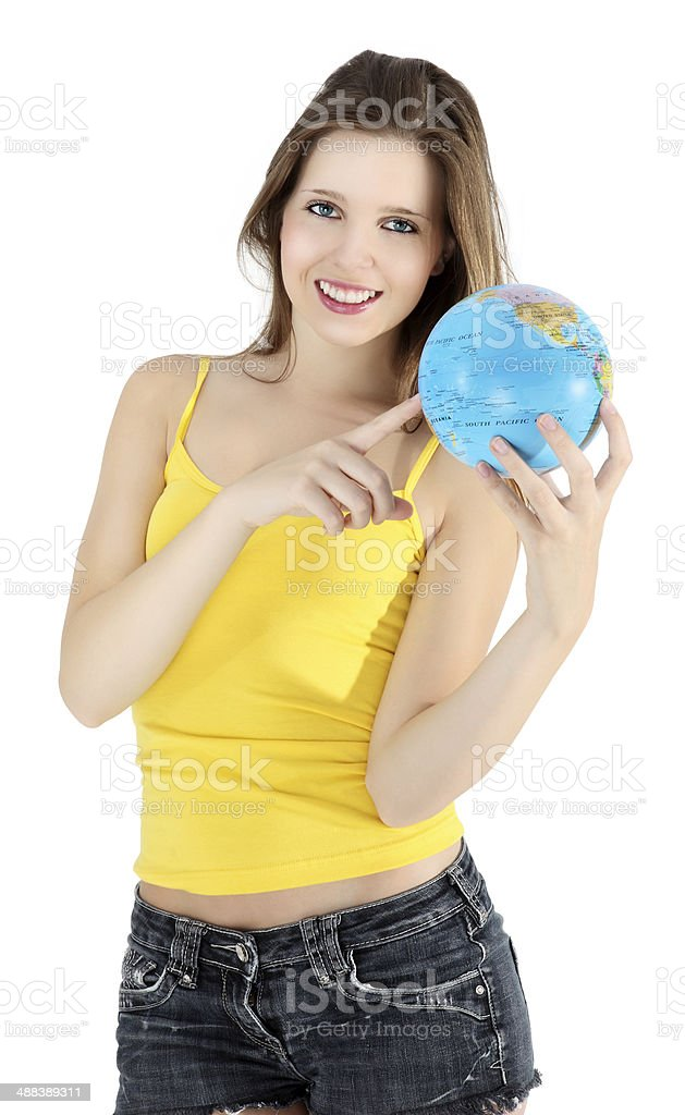 smiling girl pointing to map of the world stock photo