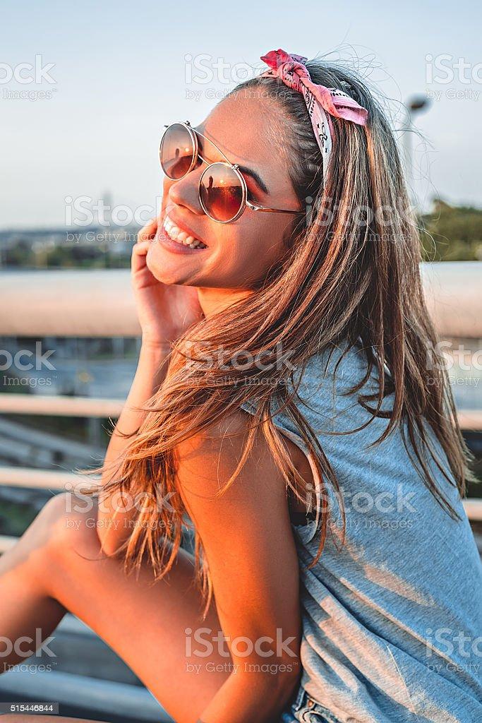Smiling girl posing on the bridge stock photo