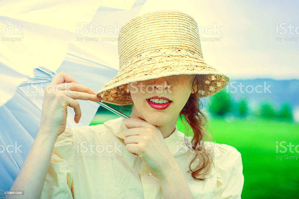 Smiling girl pulls white umbrella out on a spring day royalty-free stock photo