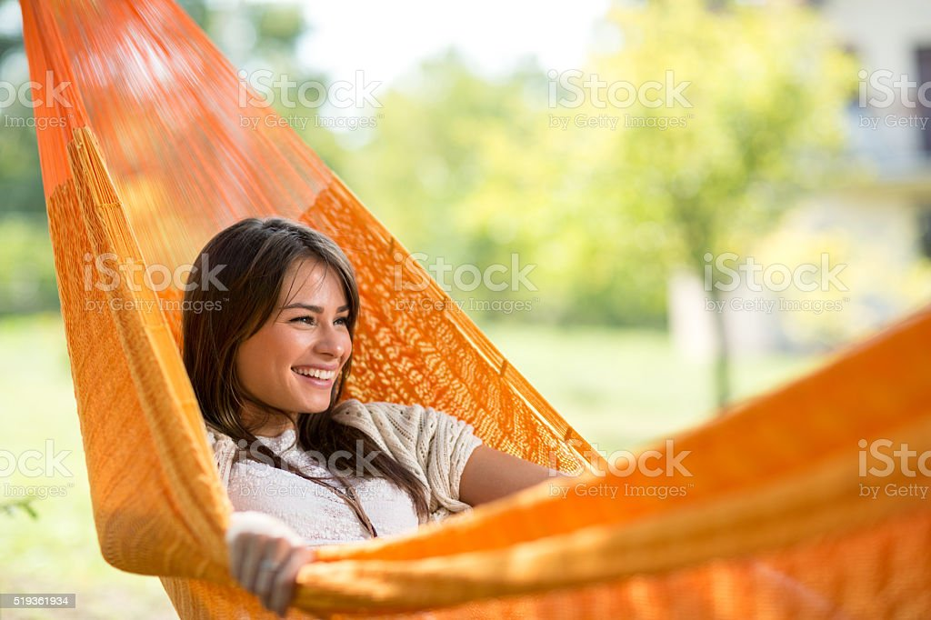 Smiling girl resting in hammock stock photo