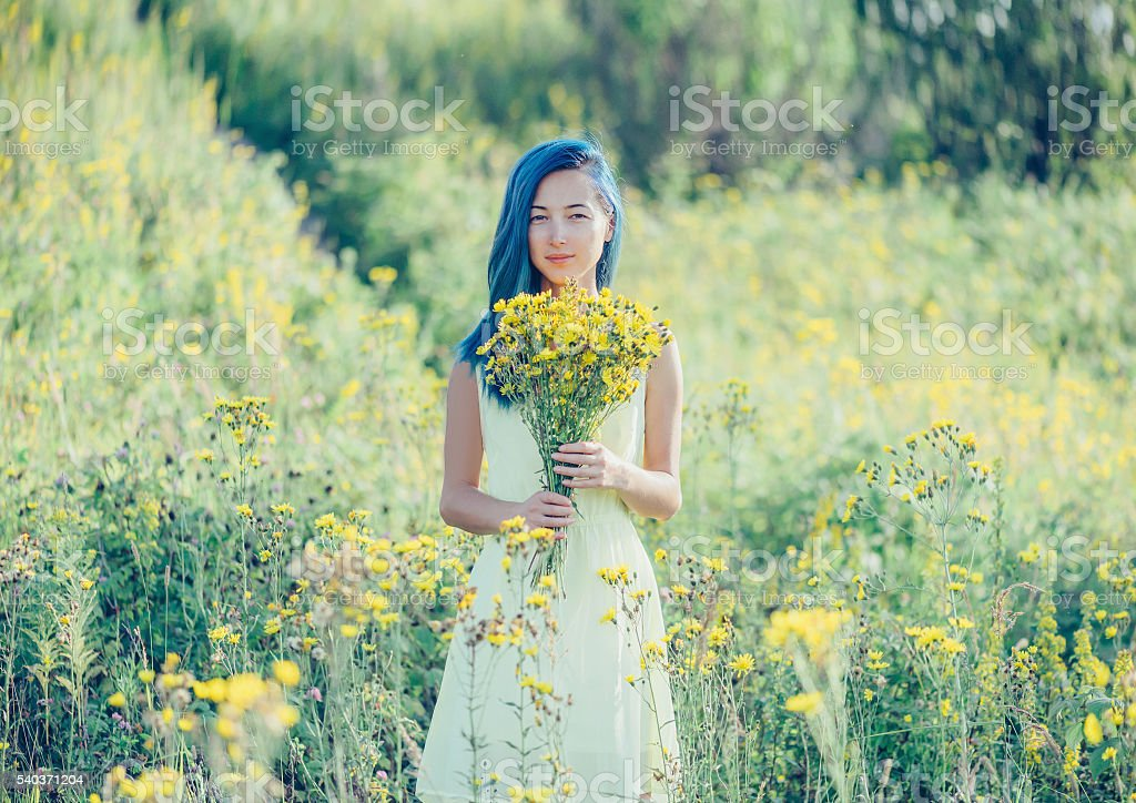 Smiling girl resting in summer field stock photo