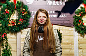 Smiling girl selling Christmas wreath at Christmas Market in Vilnius