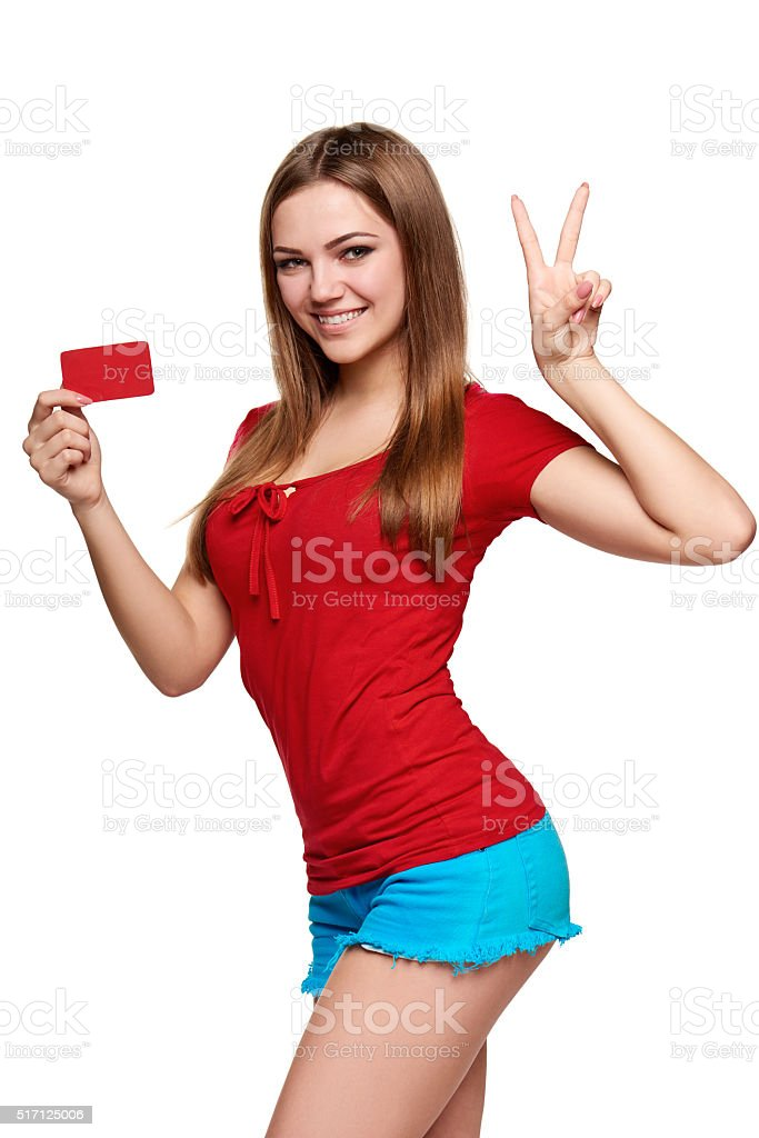 Smiling girl showing red card in hand stock photo