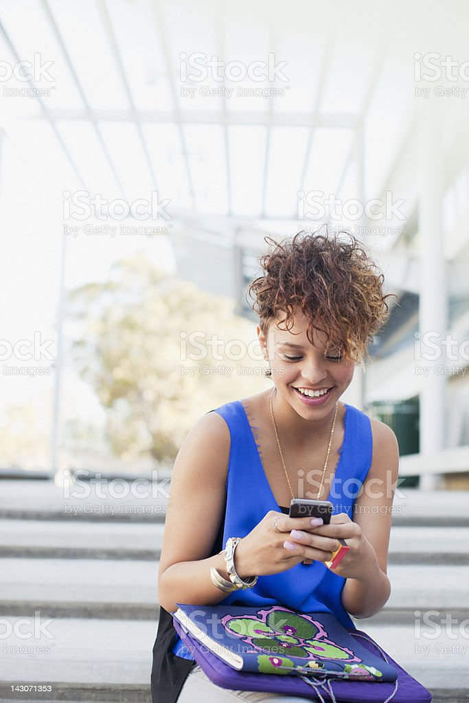 Smiling girl using cell phone royalty-free stock photo