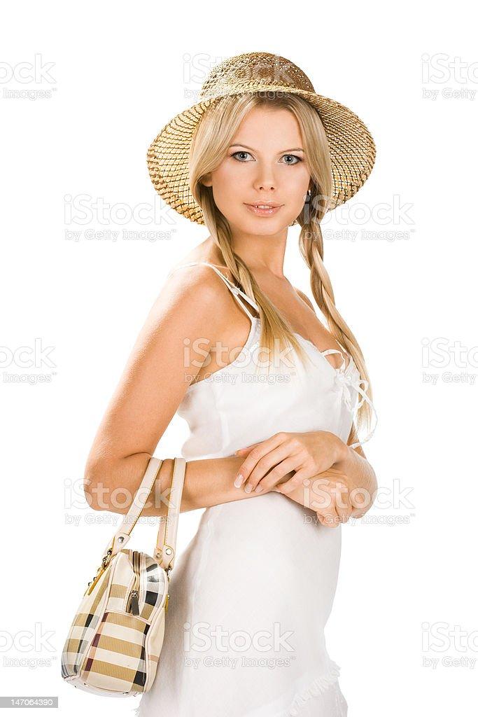 Menina sorridente com um saco em fundo branco foto de stock royalty-free