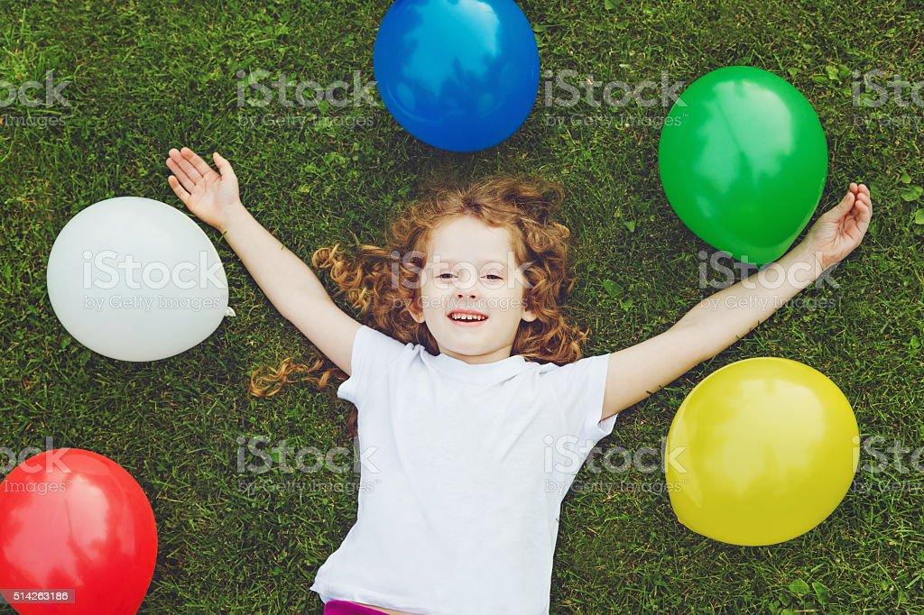 Smiling girl with arms stretched forward. stock photo