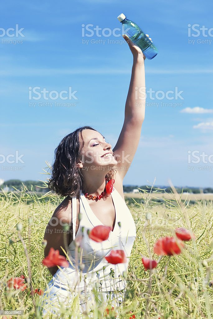 smiling girl with bottle of water royalty-free stock photo