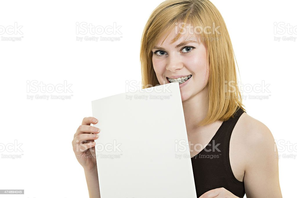 Smiling girl with brackets and white billboard royalty-free stock photo