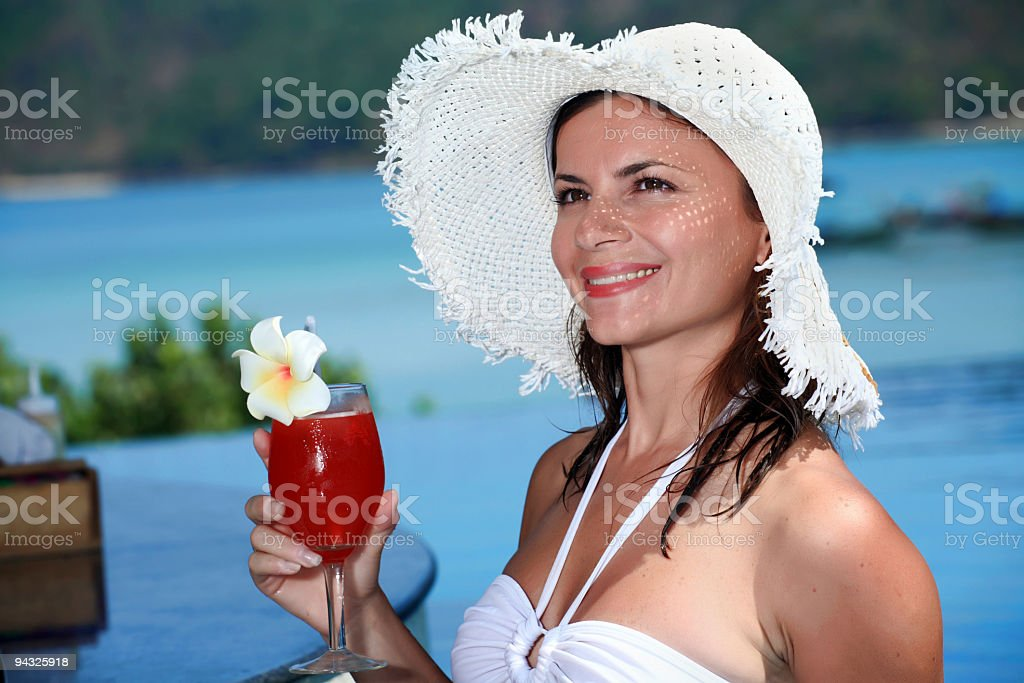 Smiling girl with  cocktail. royalty-free stock photo