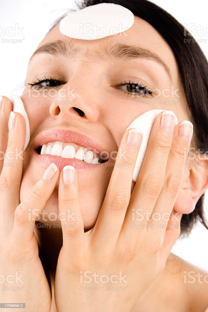 Smiling girl with cotton pads stock photo