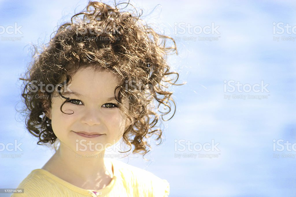Smiling Girl With Curls stock photo